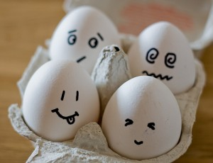 eggs in carton with faces